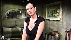 Busty brunette mistress has some fun getting her dungeon ready