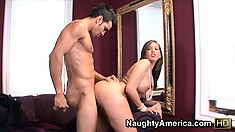 Kelly Divine shows off the contours of her curvy body while pleasing a big cock