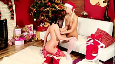 Two sexy lesbians in christmas-themed lingerie make sweet love