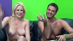 Splattering a sexy blond porn model's nice-sized titties with semen