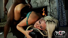 This hot blond uses her whole body to pleasure her big black friend