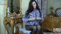 Alluring brunette with tiny tits rips her black pantyhose and plays with her holes