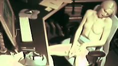 Hot little blonde gets caught on camera masturbating at work