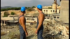 Muscular hunks sweat under the hot sun as they toil in a mine