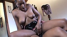 Hot black lesbian chicks have some fun with a massive strap-on