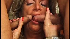 Two young boys take turns banging the naughty mature lady's fiery peach in the kitchen