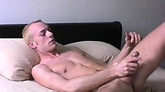 Naughty buck spreads his ass cheeks while teasing himself on camera