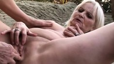 Lustful blonde grannies provide to each other intense pleasure outside