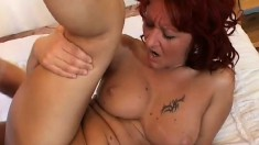 Redhead milf spreads her hot legs and a long dick fills her fiery twat